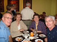 At table, John & Gail Taber McCoy, Mindy Samaha LaGrande & husband Louis, background, Jan Rogers Hager, Bill Bozeman, Pa