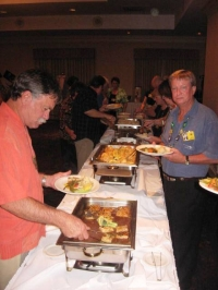 Barry Duncan & Greg Fisher filling up their plates...enjoy!