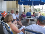 A group talking by the cabana bar during the day on Saturday.