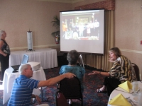 Stephanie Allen, Louis & Mindy Samaha LaGrande, Sara Walker, watching video put together by Jan Rogers..a history of us